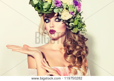 Girl with delicate flowers  wreath on the head  in hair