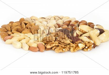 Mixed nuts - almonds, pistachios, hazelnuts, brazil nuts, walnuts, peanuts on the white background