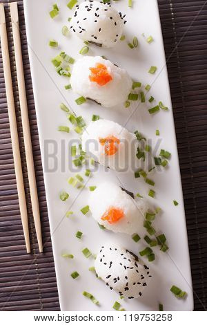 Japanese Onigiri With Salmon And Sesame Close-up. Vertical Top View