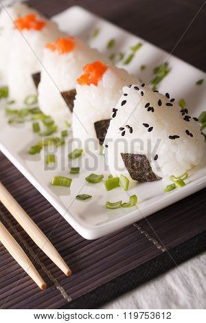 Onigiri Rice Balls With Salmon And Sesame Close-up. Vertical
