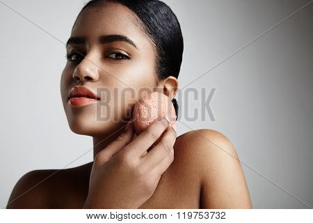 Woman Has A Facial Treatment With A Pink Konjac Sponge