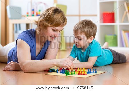 Family Playing Board Game At Home On The Floor At Home