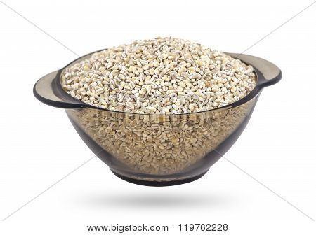 Pearl barley in bowl, isolated on white background