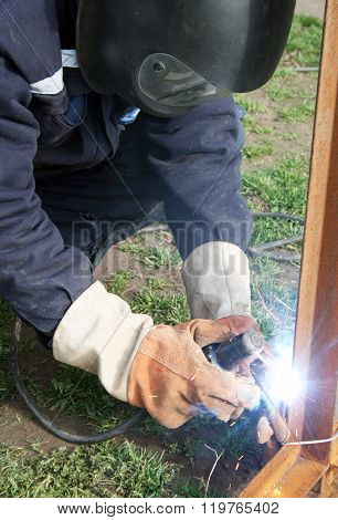 Welder welding a metal part
