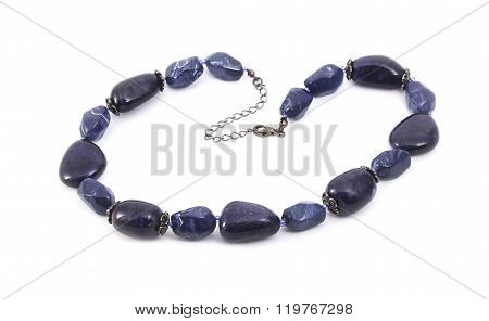 Beads of blue stones isolated on white