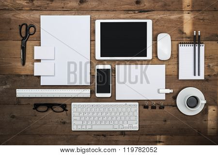 Top view letterhead and identity design template on wooden background