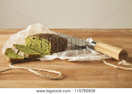 Sliced Spinach Bread Isolated With Knife On White