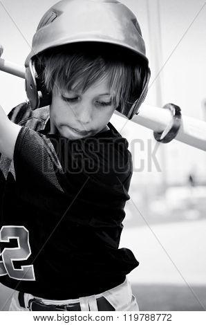 Black and white photo of baseball boy.
