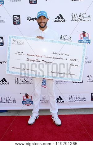 Ricky Smith and Stephen Bishop with a large donation check at the inaugural Stephen Bishop celebrity golf invitational benefiting R.A.K.E. on Feb. 15, 2016 at Calabasas Country Club in Calabasas, CA.