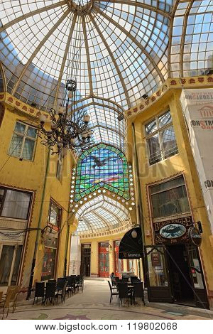 ORADEA, ROMANIA - AUGUST 01, 2015: The Black Eagle Palace equipped with a glass covered passageway is an architectural masterpiece.