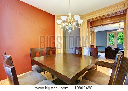 Dining Room In Red And Blue And Black Table.