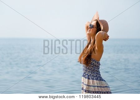 Young beautiful girl on the beach on a summer day