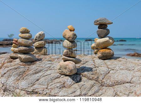 Stone pyramid on the beach against the blue sky