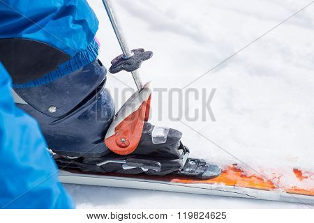 Close-up Of Ski Pole Unfasten Boot From Ski
