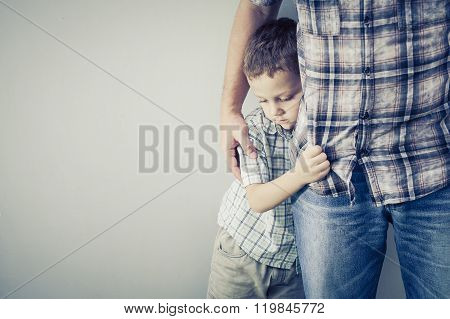 Sad Son Hugging His Dad