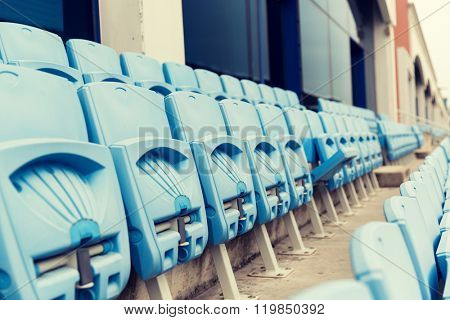 racing, motosports, extreme and motoring concept - rows with folded seats of bleachers on stadium
