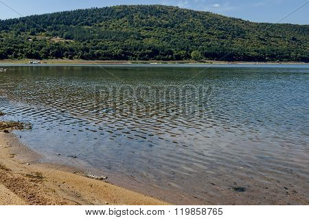 Picturesque Rabisha  lake  with authentic shore, bivouac  and mountain over Magura cave, Belogradchik, Bulgaria poster