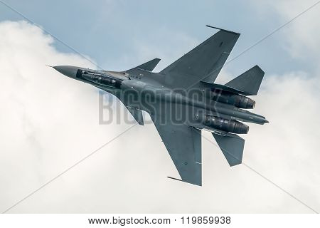 SINGAPORE, FEBRUARY 21, 2016: Sukhoi Su-30 Flanker-C of the Royal Malaysian Airforce performing a demonstration flight at the Singapore Airshow 2016. The airshow is the biggest of its kind in Asia.