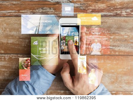 business, internet, mass media, people and technology concept - close up of male hands holding smartphone and pointing finger to web pages screen