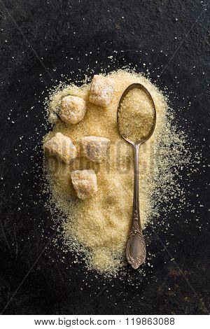 unrefined cane sugar on old table