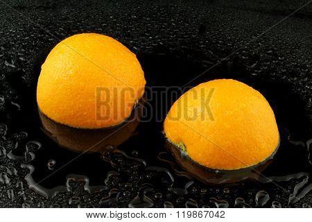 A Divided Apfelsine On Black Background