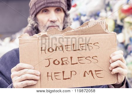 Homeless Show A Help Message Written On A Cardboard