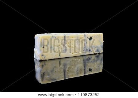 A Piece Of Blue Cheese On Black Background