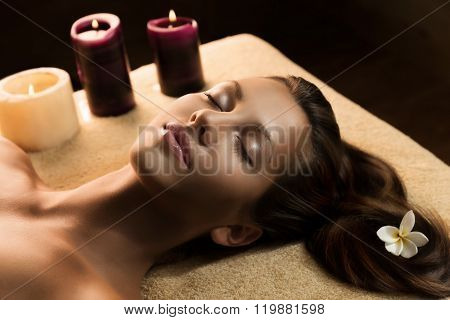 The girl relaxes in the spa