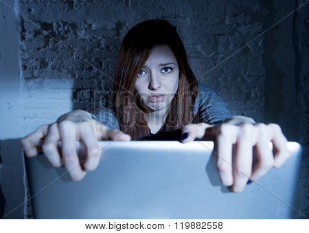 sad and scared female teenager with computer laptop suffering cyberbullying and harassment being online abused by stalker or gossip feeling desperate and humiliated in cyber bullying concept