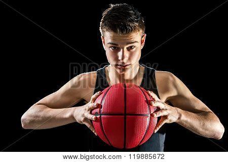 Teen Basketball Player Holding Ball.