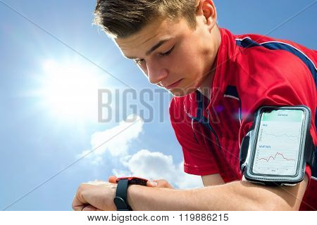 Teen Runner Checking Settings On Smart Watch.