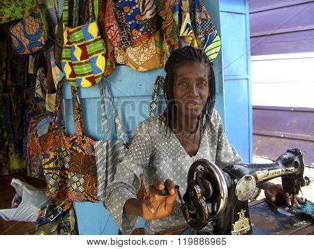 African seamstress in her shop
