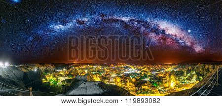 Ancient town and castle of Uchisar dug mountains, Cappadocia at night, Turkey