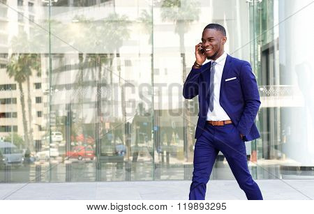 Friendly African Businessman Talking On Mobile Phone