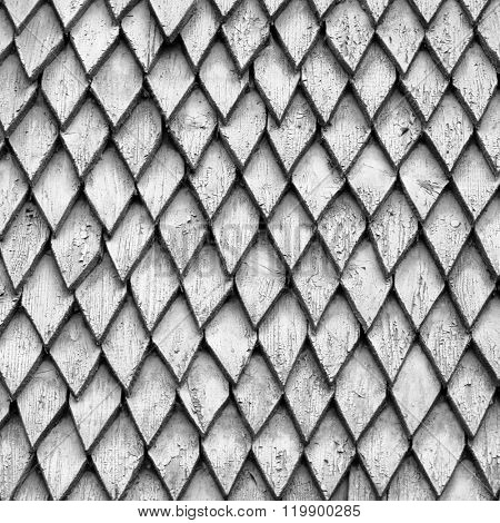 Grey wooden diamond-shaped tile texture background.