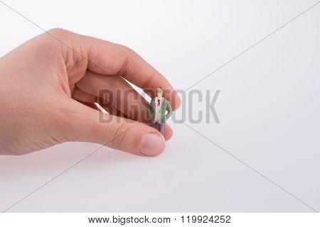 Hand Holding A Figure