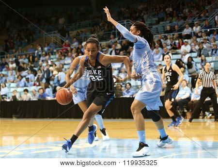 CHAPEL HILL, NC-FEB 28: Duke Blue Devils forward Oderah Chidom (22) dribbles the ball as UNC Tar Heels forward Hillary Summers (30) defends on February 28, 2016 at Carmichael Arena.