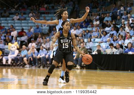 CHAPEL HILL, NC-FEB 28: Duke Blue Devils guard Kyra Lambert (15) dribbles the ball against the UNC Tar Heels on February 28, 2016 at Carmichael Arena in Chapel Hill, North Carolina.