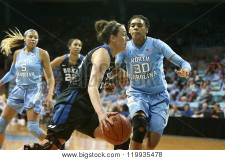 CHAPEL HILL, NC-FEB 28: Duke Blue Devils guard Rebecca Greenwell (23) dribbles the ball as UNC Tar Heels forward Hillary Summers (30) gives chase on February 28, 2016 at Carmichael Arena.