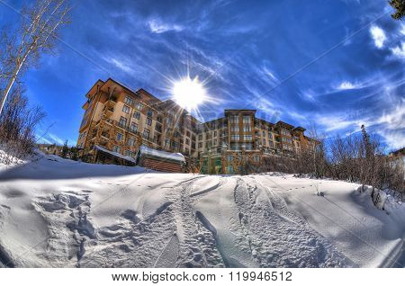 HDR image of the sun behind a ski resort in the Rockies Mountains in Snowmass