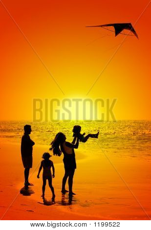 Family And A Kite At Sunset