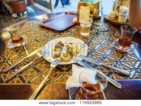 Friends eating Turkish baklava and Turkis tea in traditional Turkish cafe ** Note: Visible grain at 100%, best at smaller sizes