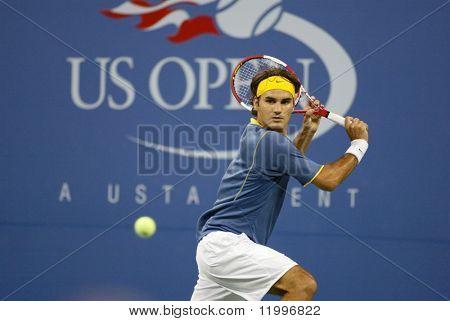 FLUSHING, NY - SEPTEMBER 4: Roger Federer of Switzerland returns the ball to Olivier Rochus of Belgium during the U.S. Open on September 4, 2005 in Flushing, New York.