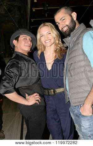 Andre Soriano, Victoria Pratt and Khoder Osman at the book signing of Pratt's new book,
