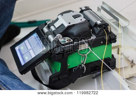 Photo of fiber optic cable splice machine poster