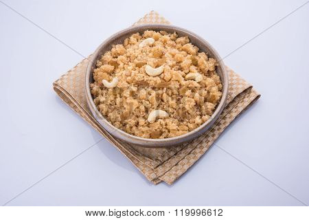 indian sweet dish sheera or shira, also known as sweet halwa in north india, served in white ceramic bowl, famous festival food, served as prasada in hindu religion