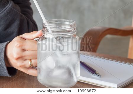 Woman's Hand Holding A Cold Glass Of Water