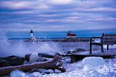 Big Waves on Lake Superior by lighthouse in Canal Park Duluth MN. Winter poster