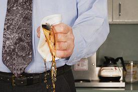 Businessman crushing coffee cup