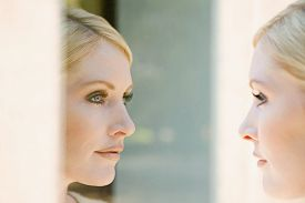 Woman looking at her reflection